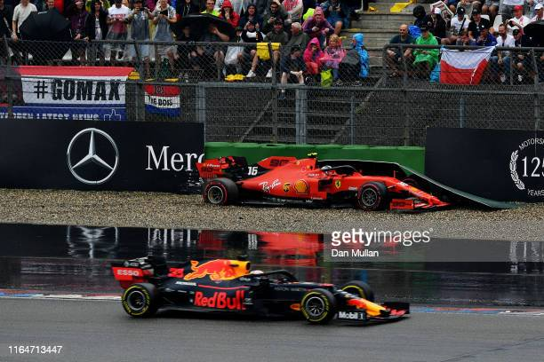 Max Verstappen of the Netherlands driving the Aston Martin Red Bull Racing RB15 passes as Charles Leclerc of Monaco driving the Scuderia Ferrari SF90...
