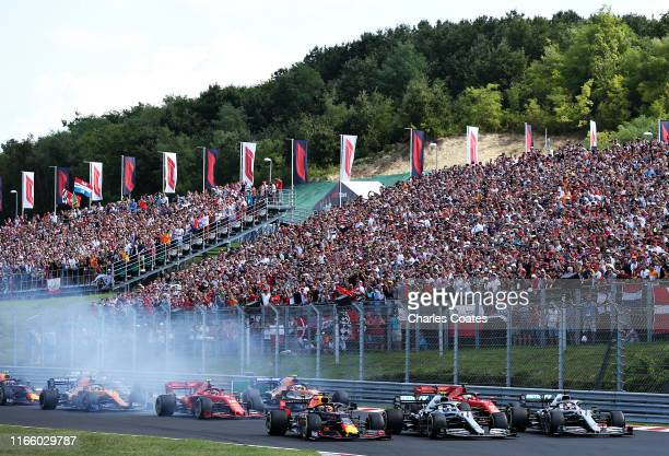 Max Verstappen of the Netherlands driving the Aston Martin Red Bull Racing RB15 Valtteri Bottas driving the Mercedes AMG Petronas F1 Team Mercedes...