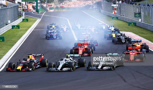 Max Verstappen of the Netherlands driving the Aston Martin Red Bull Racing RB15, Valtteri Bottas driving the Mercedes AMG Petronas F1 Team Mercedes...