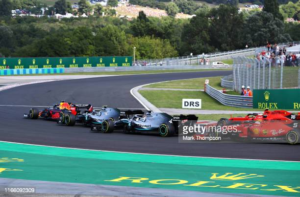 Max Verstappen of the Netherlands driving the Aston Martin Red Bull Racing RB15 leads the field at the start during the F1 Grand Prix of Hungary at...