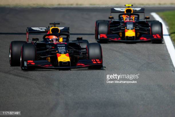 Max Verstappen of the Netherlands driving the Aston Martin Red Bull Racing RB15 and Alexander Albon of Thailand driving the Aston Martin Red Bull...