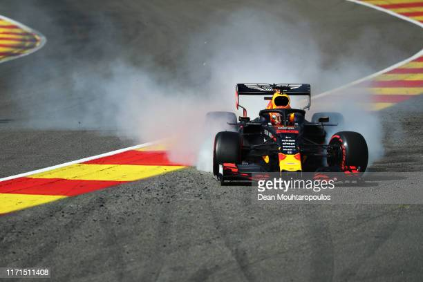 Max Verstappen of the Netherlands driving the Aston Martin Red Bull Racing RB15 runs off track at the start during the F1 Grand Prix of Belgium at...