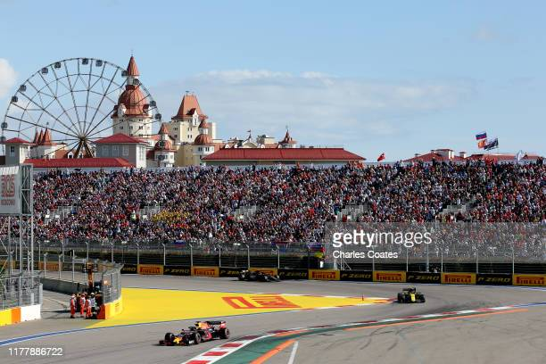 Max Verstappen of the Netherlands driving the Aston Martin Red Bull Racing RB15 leads Nico Hulkenberg of Germany driving the Renault Sport Formula...