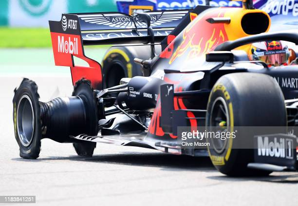 Max Verstappen of the Netherlands driving the Aston Martin Red Bull Racing RB15 loses his right rear tyre to a puncture during the F1 Grand Prix of...