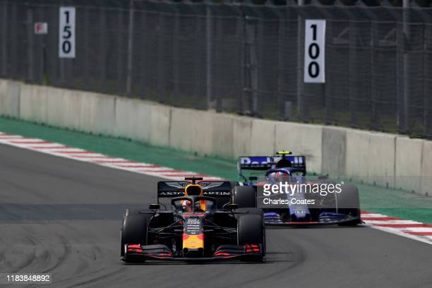 Max Verstappen of the Netherlands driving the Aston Martin Red Bull Racing RB15 leads Pierre Gasly of France driving the Scuderia Toro Rosso STR14...