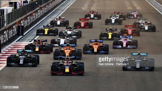 Max Verstappen of the Netherlands driving the Aston Martin Red Bull Racing RB16 leads Lewis Hamilton of Great Britain driving the Mercedes AMG...