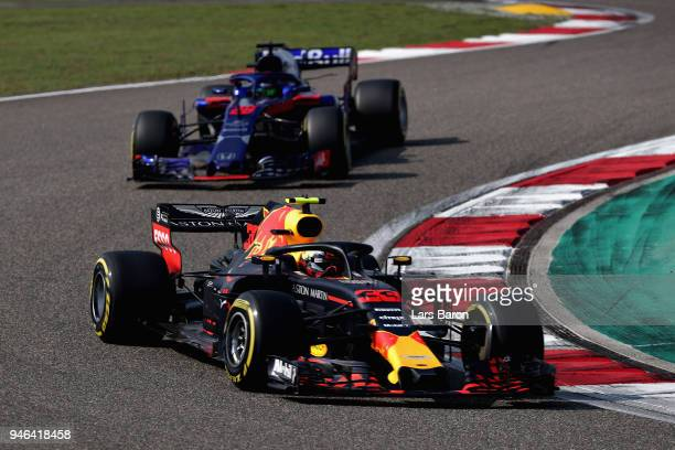 Max Verstappen of the Netherlands driving the Aston Martin Red Bull Racing RB14 TAG Heuer leads Brendon Hartley of New Zealand driving the Scuderia...