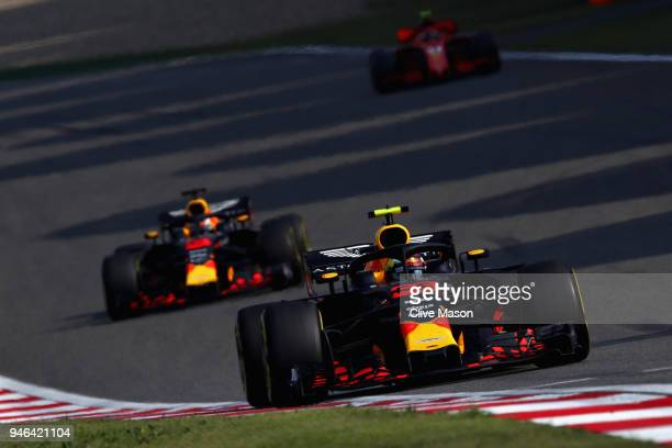 Max Verstappen of the Netherlands driving the Aston Martin Red Bull Racing RB14 TAG Heuer leads Daniel Ricciardo of Australia driving the Aston...