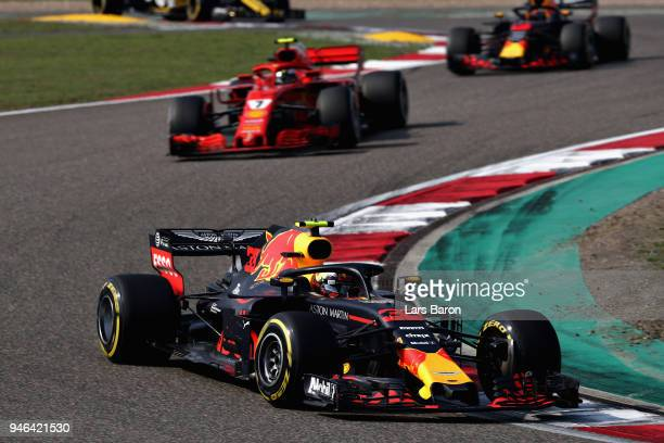 Max Verstappen of the Netherlands driving the Aston Martin Red Bull Racing RB14 TAG Heuer leads Kimi Raikkonen of Finland driving the Scuderia...