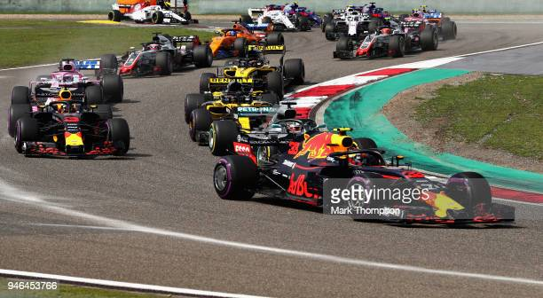 Max Verstappen of the Netherlands driving the Aston Martin Red Bull Racing RB14 TAG Heuer leads Lewis Hamilton of Great Britain driving the Mercedes...