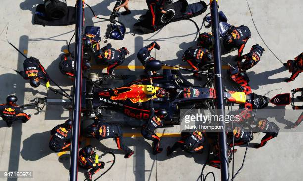Max Verstappen of the Netherlands driving the Aston Martin Red Bull Racing RB14 TAG Heuer makes a pit stop for new tyres during the Formula One Grand...
