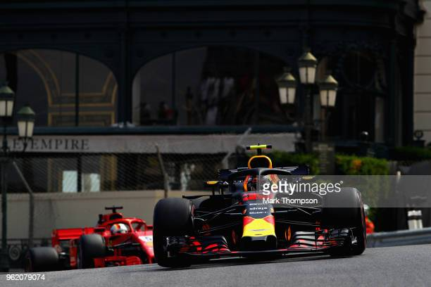 Max Verstappen of the Netherlands driving the Aston Martin Red Bull Racing RB14 TAG Heuer leads Sebastian Vettel of Germany driving the Scuderia...