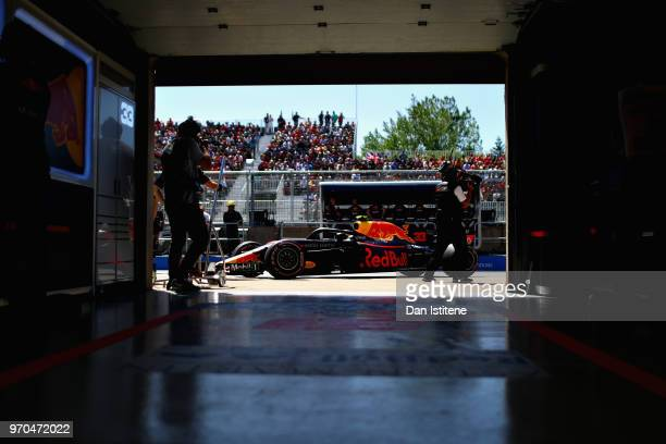 Max Verstappen of the Netherlands driving the Aston Martin Red Bull Racing RB14 TAG Heuer stops outside his garage during qualifying for the Canadian...