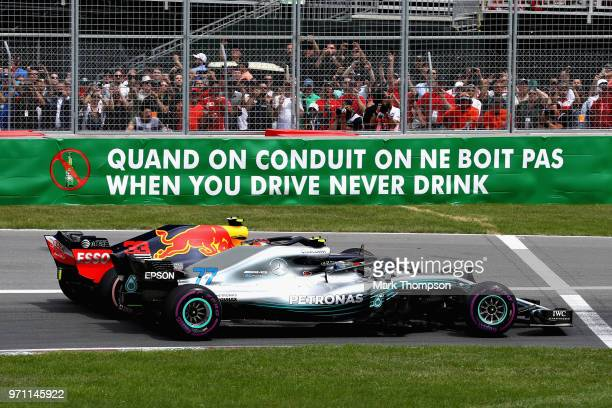 Max Verstappen of the Netherlands driving the Aston Martin Red Bull Racing RB14 TAG Heuer and Valtteri Bottas driving the Mercedes AMG Petronas F1...