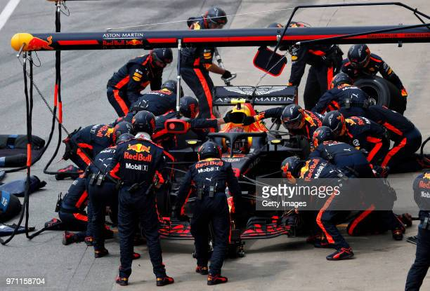 Max Verstappen of the Netherlands driving the Aston Martin Red Bull Racing RB14 TAG Heuer makes a pitstop for new tyres during the Canadian Formula...