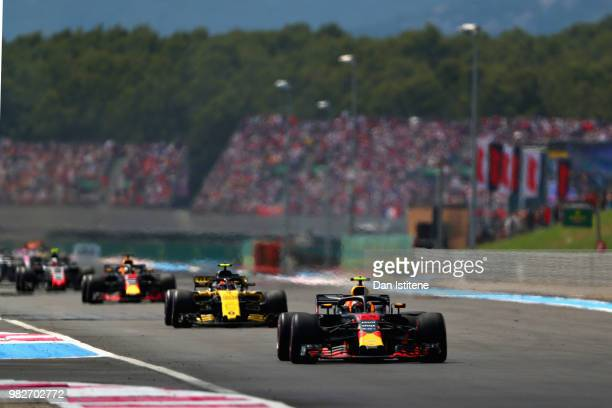 Max Verstappen of the Netherlands driving the Aston Martin Red Bull Racing RB14 TAG Heuer leads Carlos Sainz of Spain driving the Renault Sport...