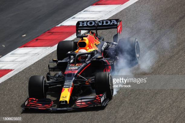 Max Verstappen of the Netherlands driving the Red Bull Racing RB16B Honda locks up during Day One of F1 Testing at Bahrain International Circuit on...