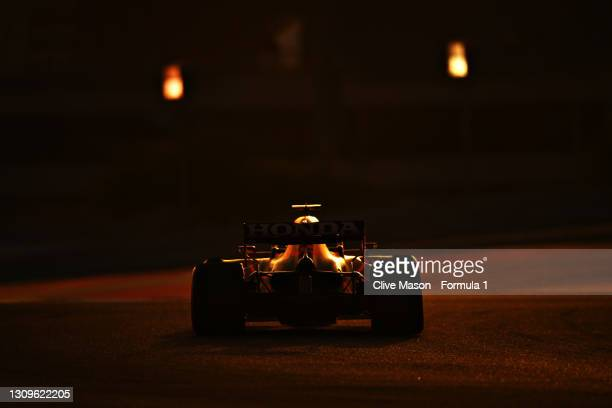Max Verstappen of the Netherlands driving the Red Bull Racing RB16B Honda on his way to the grid prior to the F1 Grand Prix of Bahrain at Bahrain...