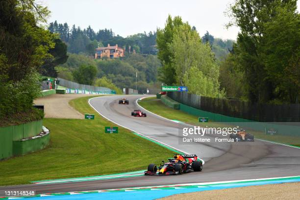 Max Verstappen of the Netherlands driving the Red Bull Racing RB16B Honda leads Lando Norris of Great Britain driving the McLaren F1 Team MCL35M...