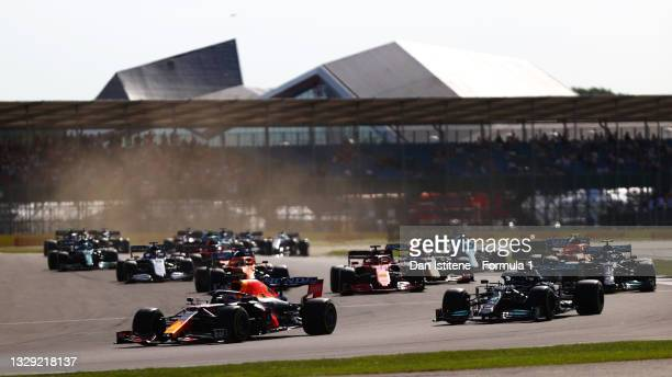Max Verstappen of the Netherlands driving the Red Bull Racing RB16B Honda leads Lewis Hamilton of Great Britain driving the Mercedes AMG Petronas F1...