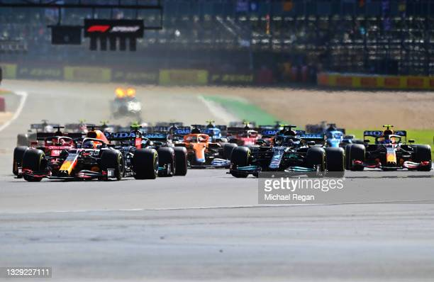 Max Verstappen of the Netherlands driving the Red Bull Racing RB16B Honda leads the field into turn one at the start during the Sprint for the F1...