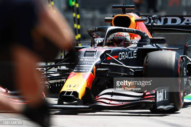 Max Verstappen of the Netherlands driving the Red Bull Racing RB16B Honda makes a pitstop during practice ahead of the F1 Grand Prix of Hungary at...