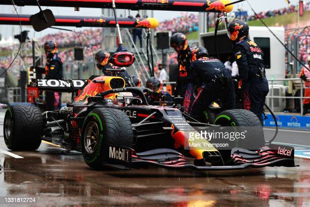 Max Verstappen of the Netherlands driving the Red Bull Racing RB16B Honda makes a pitstop during the F1 Grand Prix of Hungary at Hungaroring on...