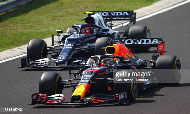 Max Verstappen of the Netherlands driving the Red Bull Racing RB16B Honda leads Pierre Gasly of France driving the Scuderia AlphaTauri AT02 Honda...