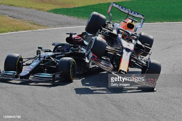 Max Verstappen of the Netherlands driving the Red Bull Racing RB16B Honda and Lewis Hamilton of Great Britain driving the Mercedes AMG Petronas F1...