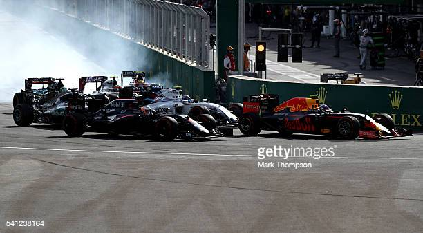 Max Verstappen of the Netherlands driving the Red Bull Racing Red BullTAG Heuer RB12 TAG Heuer leads Valtteri Bottas of Finland driving the Williams...