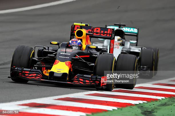 Max Verstappen of the Netherlands driving the Red Bull Racing Red BullTAG Heuer RB12 TAG Heuer leads Lewis Hamilton of Great Britain driving the...