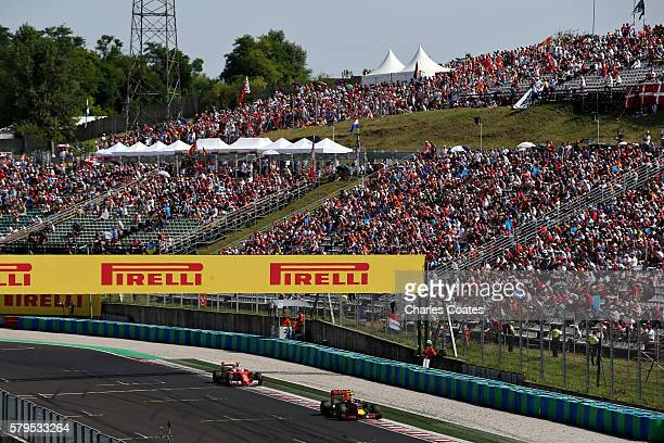 Max Verstappen of the Netherlands driving the Red Bull Racing Red BullTAG Heuer RB12 TAG Heuer leads Kimi Raikkonen of Finland driving the Scuderia...