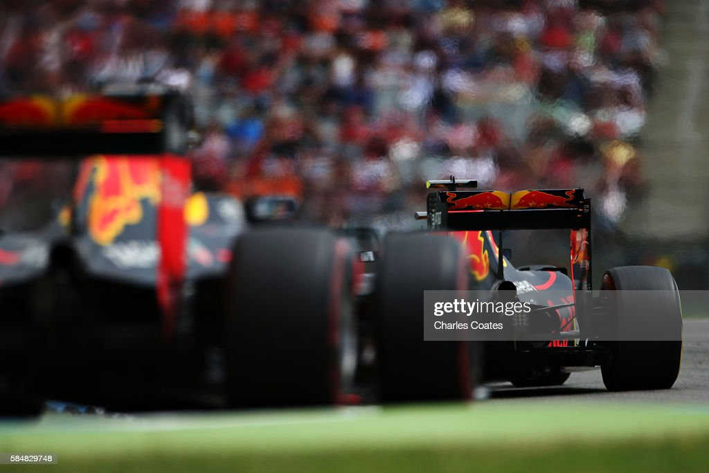 Max Verstappen of the Netherlands driving the (33) Red Bull Racing Red Bull-TAG Heuer RB12 TAG Heuer leads Daniel Ricciardo of Australia driving the (3) Red Bull Racing Red Bull-TAG Heuer RB12 TAG Heuer on track during the Formula One Grand Prix of Germany at Hockenheimring on July 31, 2016 in Hockenheim, Germany.