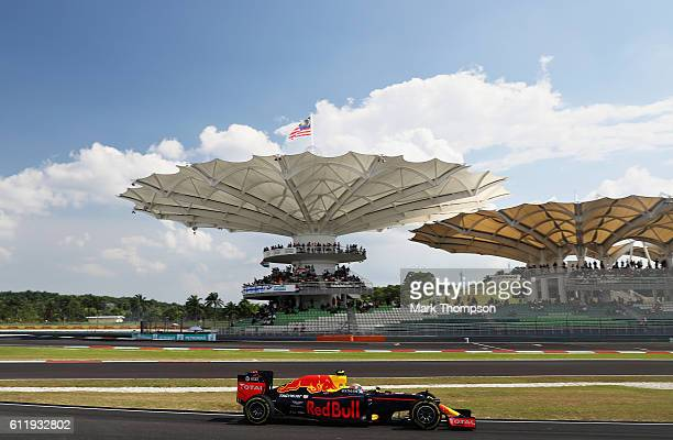 Max Verstappen of the Netherlands driving the Red Bull Racing Red BullTAG Heuer RB12 TAG Heuer comes into the pits during the Malaysia Formula One...