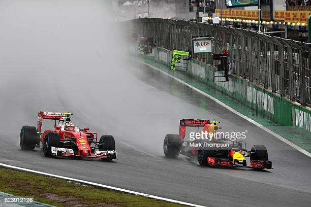 Max Verstappen of the Netherlands driving the Red Bull Racing Red BullTAG Heuer RB12 TAG Heuer overtakes Kimi Raikkonen of Finland driving the...