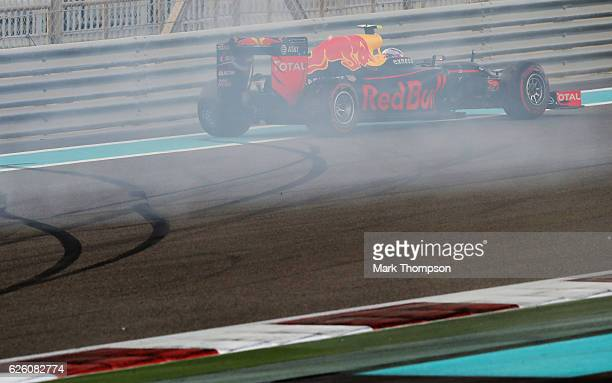 Max Verstappen of the Netherlands driving the Red Bull Racing Red BullTAG Heuer RB12 TAG Heuer spins on track during the Abu Dhabi Formula One Grand...