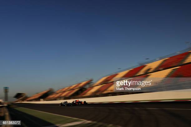 Max Verstappen of the Netherlands driving the Red Bull Racing Red BullTAG Heuer RB13 TAG Heuer and Lewis Hamilton of Great Britain driving the...