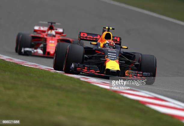 Max Verstappen of the Netherlands driving the Red Bull Racing Red BullTAG Heuer RB13 TAG Heuer lads Sebastian Vettel of Germany driving the Scuderia...
