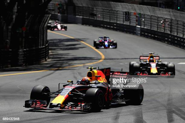 Max Verstappen of the Netherlands driving the Red Bull Racing Red Bull-TAG Heuer RB13 TAG Heuer leads Daniel Ricciardo of Australia driving the Red...
