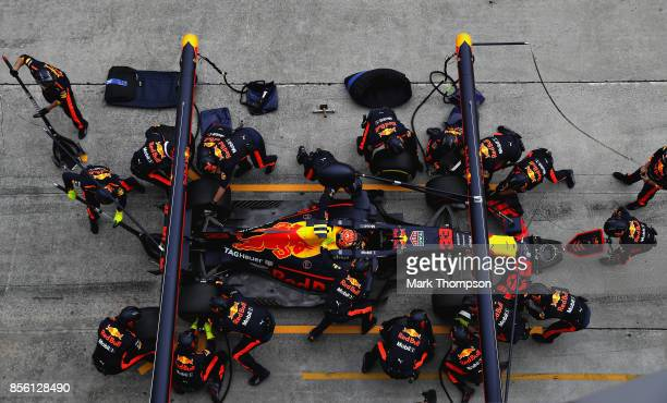 Max Verstappen of the Netherlands driving the Red Bull Racing Red BullTAG Heuer RB13 TAG Heuer makes a pit stop for new tyres during the Malaysia...