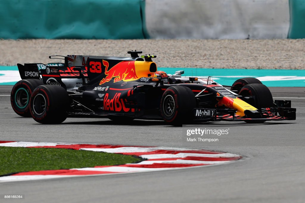 Max Verstappen of the Netherlands driving the (33) Red Bull Racing Red Bull-TAG Heuer RB13 TAG Heuer overtakes Lewis Hamilton of Great Britain driving the (44) Mercedes AMG Petronas F1 Team Mercedes F1 WO8 on track during the Malaysia Formula One Grand Prix at Sepang Circuit on October 1, 2017 in Kuala Lumpur, Malaysia.