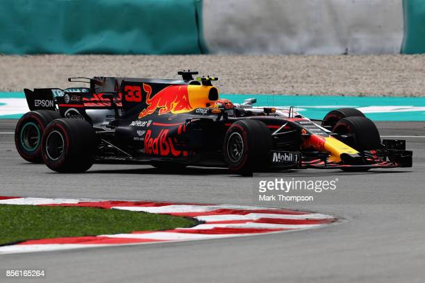 Max Verstappen of the Netherlands driving the Red Bull Racing Red BullTAG Heuer RB13 TAG Heuer overtakes Lewis Hamilton of Great Britain driving the...