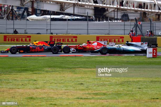 Max Verstappen of the Netherlands driving the Red Bull Racing Red BullTAG Heuer RB13 TAG Heuer Sebastian Vettel of Germany driving the Scuderia...