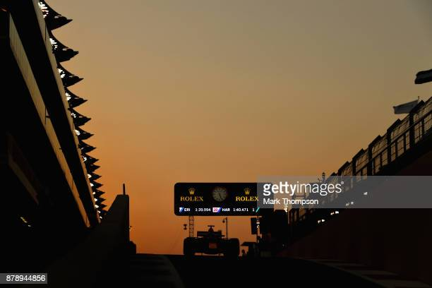 Max Verstappen of the Netherlands driving the Red Bull Racing Red BullTAG Heuer RB13 TAG Heuer in the Pitlane during qualifying for the Abu Dhabi...
