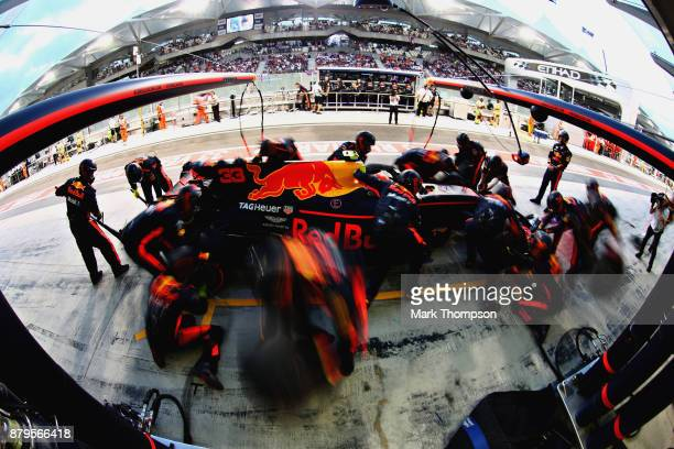 Max Verstappen of the Netherlands driving the Red Bull Racing Red BullTAG Heuer RB13 TAG Heuer makes a pit stop during the Abu Dhabi Formula One...