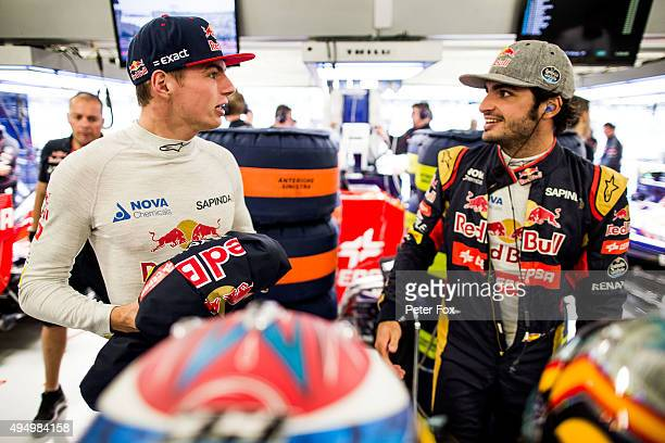 Max Verstappen of The Netherlands with Carlos Sainz of Spain both of Scuderia Toro Rosso during practice for the Formula One Grand Prix of Mexico at...