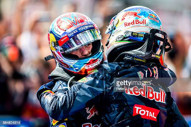 Max Verstappen of The Netherlands with Daniel Ricciardo of Australia both of Red Bull Racing during the Formula One Grand Prix of Germany at...