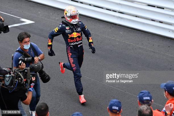 Max Verstappen runs toward his team after he won the F1 Grand Prix of Monaco at Circuit de Monaco on May 23, 2021 in Monte-Carlo, Monaco.