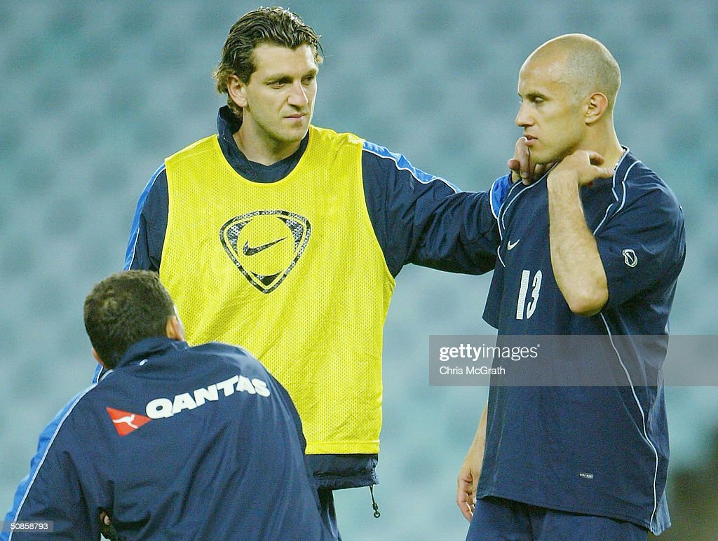 Max Vieri (L) and Marco Bresciano (R) of the Socceroos have a chat during Australian Socceroos training held at Aussie Stadium, May 20, 2004 in Sydney Australia.