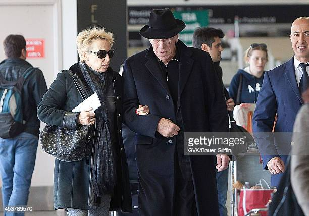 Max Von Sydow and his wife Catherine Brelet is seen at Los Angeles International Airport on February 29 2012 in Los Angeles California